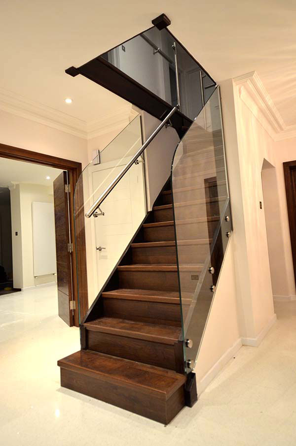 Glass stair balustrade with steel handrail