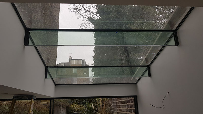 Glass beam roof light
