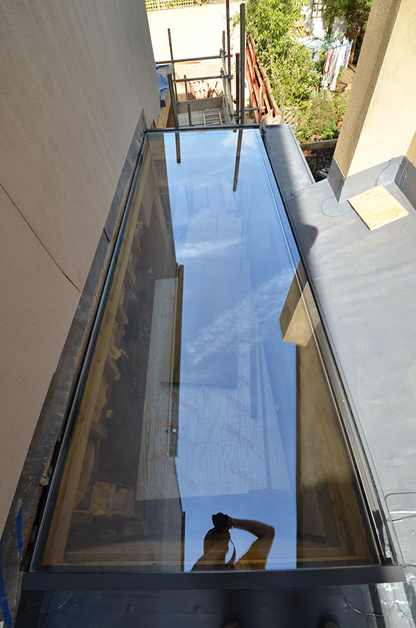 Glass flat roof light